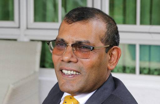 Former Maldives President Mohamed Nasheed smiles during an interview with Associated Press in Colombo, Sri Lanka, Friday, Feb. 2, 2018. The Maldives' Supreme Court ordered the release of imprisoned politicians, including exiled ex-President Nasheed, saying their guilty verdicts had been politically influenced.