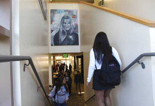 "In this Tuesday, Jan. 30, 2018 photo provided by Sophia Muys, students pass under one of James Franco's paintings displayed above a stairwell in the Media Arts Center at Palo Alto High School in Palo Alto, Calif. Actor and director Franco is a 1996 graduate of the school. Franco's former high school has taken down a mural he painted and plans to remove other art donated by the celebrity alumnus who is facing allegations of sexual misconduct in Hollywood. A statement from the school district Thursday, Feb. 1, 2018, said removing the artwork was ""in the best interests of our students.""  (Sophia Muys/Paly Voice via AP)"