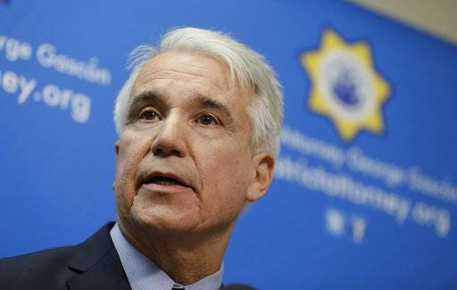 FILE - In this Dec. 9, 2014 file photo, San Francisco District Attorney George Gascon speaks during a news conference in San Francisco. San Francisco's district attorney says his office will toss out or reduce thousands of marijuana criminal convictions dating back decades, which a 2016 ballot measure legalizing recreational use of the drug in California allows. Gascon announced Wednesday, Jan. 31, 2018, that his office will review nearly 5,000 felony cases for possible action and automatically seal 3,000 misdemeanor cases.