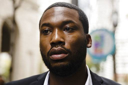 File-This Nov. 6, 2017, file photo shows Rapper Meek Mill arriving at the criminal justice center in Philadelphia.  A Philadelphia judge who has become a target after sentencing Meek Mill to prison on a probation violation has hired her own lawyer who's threatening to sue for defamation. Attorney A. Charles Peruto Jr. said Thursday, Feb. 1, 2018,  that Judge Genece Brinkley hired him last week. He says Mill's legal team has been making baseless claims to the media about the judge's personal and professional conduct.