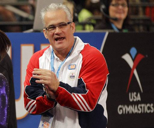 FILE - In this March 3, 2012, file photo, gymnastics coach John Geddert is seen at the American Cup gymnastics meet at Madison Square Garden in New York. Gymnasts who were molested by sports doctor Larry Nassar are reserving harsh criticism for former U.S. Olympic coach John Geddert, who for years had Nassar treat their injuries at his elite Twistars club near Lansing. His victims have complained that the coach created an ultra-competitive atmosphere, was indifferent to injuries and rarely offered gymnasts any choice to see a different doctor.