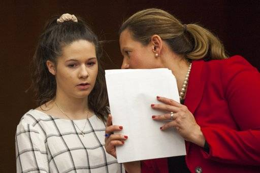 Erin Blayer, left, listens to Michigan Assistant Attorney General Angela Povilaitis before giving her statement during Larry Nassar's sentencing at Eaton County Circuit Court in Charlotte on Wednesday, Jan. 31, 2018. The former Michigan State University sports-medicine and USA Gymnastics doctor is being sentenced for three first degree criminal sexual abuse charges related to assaults that occurred at Twistars, a gymnastics facility in Dimondale. Nassar has also been sentenced to 60 years in prison for three child pornography charges in federal court and between 40 to 175 years in Ingham County for seven counts of criminal sexual conduct. (Cory Morse /The Grand Rapids Press via AP)