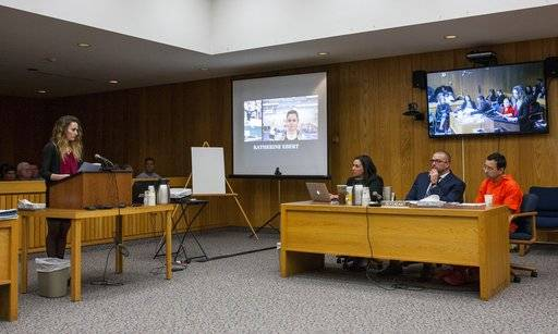 Katherine Ebert, left, gives her statement during Larry Nassar's sentencing at Eaton County Circuit Court in Charlotte, Mich., on Wednesday, Jan. 31, 2018. Nassar is seated far right. The former Michigan State University sports-medicine and USA Gymnastics doctor is being sentenced for three first degree criminal sexual abuse charges related to assaults that occurred at Twistars, a gymnastics facility in Dimondale. Nassar has also been sentenced to 60 years in prison for three child pornography charges in federal court and between 40 to 175 years in Ingham County for seven counts of criminal sexual conduct. (Cory Morse /The Grand Rapids Press via AP)