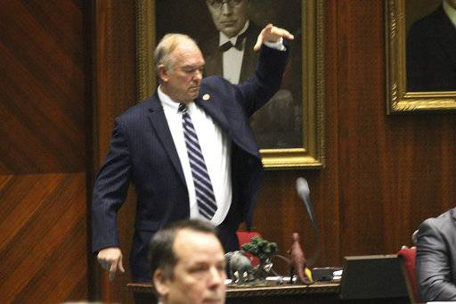 Arizona Republican state Rep. Don Shooter drops his mic after voting no on a resolution expelling him from the Arizona House for a pattern of sexual harassment in Phoenix, Ariz., Thursday, Feb. 1, 2018. Shooter's removal from office would be the first known vote kicking out a state lawmaker since revelations against filmmaker Harvey Weinstein spurred a national conversation on workplace harassment.