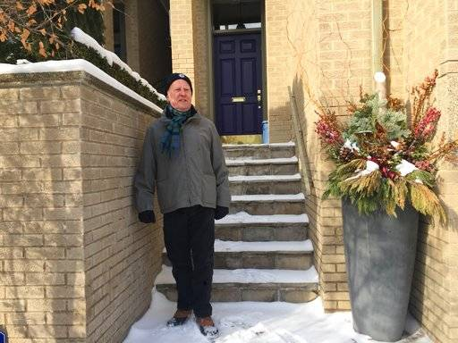 In this Jan. 31, 2018 photo, Vian Ewart stands by a planter that police investigated at his town house in the Yonge and St. Clair neighborhood of Toronto, Canada. Ewart quickly figured out why police showed up at his elegant town house with a cadaver dog to search the waist-high stone planter at his doorstep: his landscaper Bruce McArthur is a suspected serial killer.