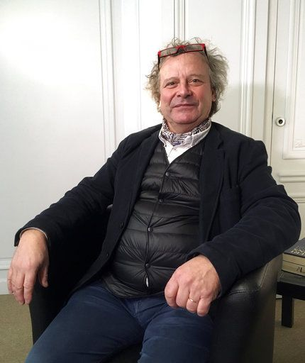 "Frederic Durand-Baissas, a 59-year-old Parisian teacher and art lover, poses during an interview in Paris, Thursday, Feb. 1, 2018.  Durand-Baissas, whose Facebook account was suspended in 2011 after he posted a photo of Gustave Courbet's 1866 painting ""The Origin of the World,"" which depicts female genitalia, is suing the California-based social network Facebook for alleged ""censorship""."