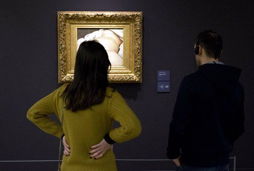 "FILE - In this Feb.12 2016 file photo,visitors watch Gustave Courbet's 1866 ""The Origin of the World,"" at Musee d'Orsay museum, in Paris. A French teacher, whose Facebook account was suspended in 2011 after he posted a photo of a famous 19th-century nude painting, is suing Thursday Feb. 1, 2018 the California-based social network Facebook for alleged ""censorship"". Frederic Durand-Baissas, a 59-year-old Parisian teacher and art lover, posted a photo of ""The Origin of the World,"" which depicts female genitalia."