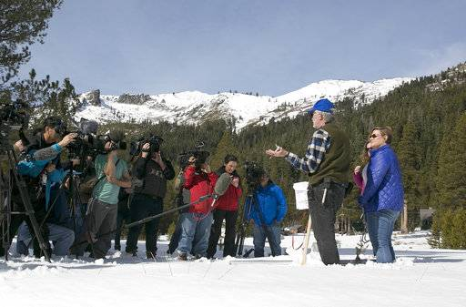 Frank Gehrke, second from right, chief of the California Cooperative Snow Surveys Program for the Department of Water Resources, talks to reporters after conducting the second snow survey of the season Thursday, Feb. 1, 2018, near Echo Summit, Calif. The snow survey showed the snow pack at this location at 13.6 inches of deep with a water content of 2.6 inches.