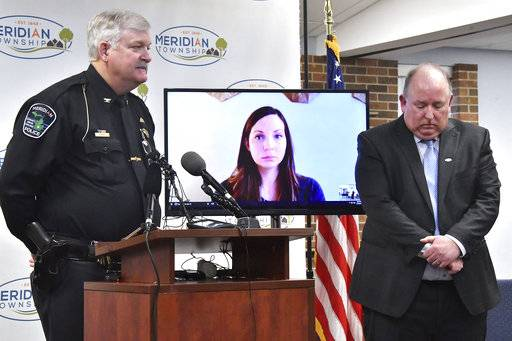 Brianne Randall-Gay listens-in from Seattle via Skype, as Meridian Two Manager Frank Walsh, right, and Chief of Police Dan Hall make a public apology Thursday, Feb. 1, 2018, for the department's failure to investigate Larry Nassar in 2004. (Dale G Young /Detroit News via AP)