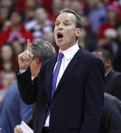 Northwestern head coach Chris Collins yells to his team during the second half of an NCAA college basketball game against Wisconsin on Thursday, Feb. 1, 2018, in Madison, Wis. Northwestern won 60-52.