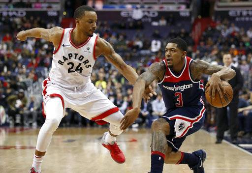 Toronto Raptors forward Norman Powell (24) guards Washington Wizards guard Bradley Beal (3) during the second half of an NBA basketball game Thursday, Feb. 1, 2018, in Washington. The Wizards won 122-119.
