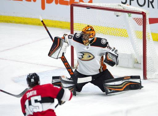 Ottawa Senators left wing Zack Smith puts a shot off the crossbar over the shoulder of Anaheim Ducks goaltender Ryan Miller during the second period of an NHL hockey game Thursday, Feb. 1, 2018, in Ottawa, Ontario. (Adrian Wyld/The Canadian Press via AP)