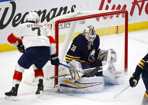 Florida Panthers forward Colton Sceviour (7) puts the puck past Buffalo Sabres goalie Chad Johnson (31) during the third period of an NHL hockey game, Thursday, Feb. 1, 2018, in Buffalo, N.Y.