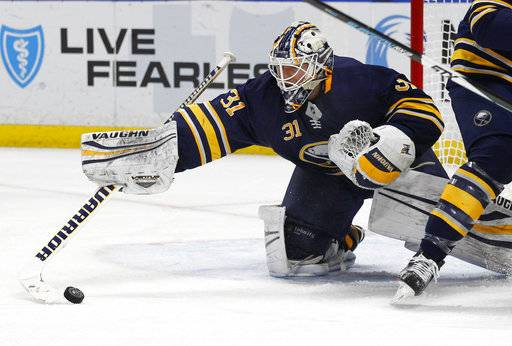 Buffalo Sabres goalie Chad Johnson (31) makes a save during the second period of an NHL hockey game against the Florida Panthers, Thursday, Feb. 1, 2018, in Buffalo, N.Y.
