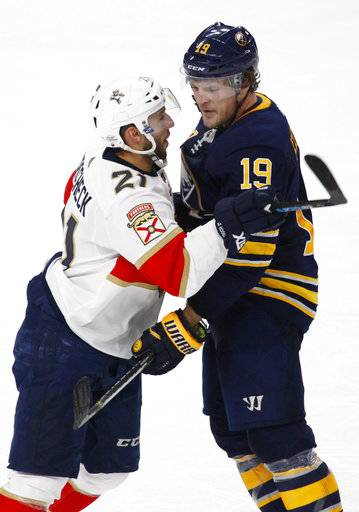 Buffalo Sabres Jake McCabe (19) and Florida Panthers Vincent Trocheck (21) exchange words during the third period of an NHL hockey game, Thursday, Feb. 1, 2018, in Buffalo, N.Y.
