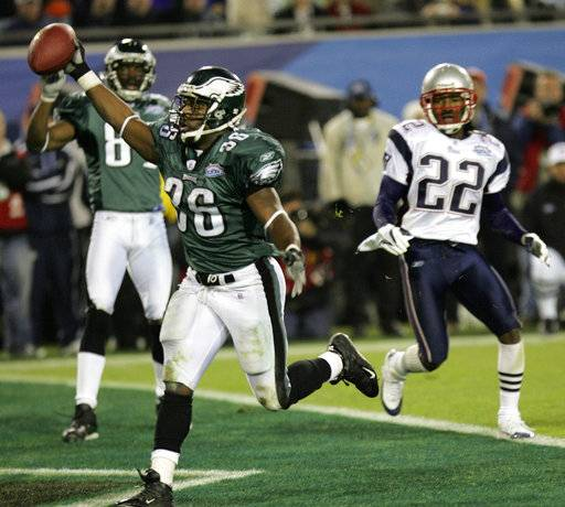 FILE - In this Feb. 6, 2005, file photo, Philadelphia Eagles running back Brian Westbrook celebrates his 10-yard touchdown reception in the third quarter against the New England Patriots during Super Bowl XXXIX at Alltel Stadium in Jacksonville, Fla. The two teams meet in a rematch in Super Bowl 52 on Sunday, Feb. 4, 2018, in Minneapolis.