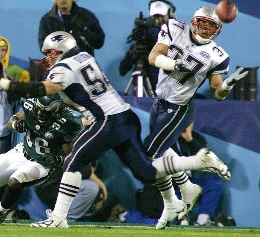 FILE - In this Feb. 6, 2005, file photo, New England Patriots safety Rodney Harrison (37) intercepts a pass intended for Philadelphia Eagles' Brian Westbrook (36) as Patriots linebacker Tedy Bruschi (54) helps on the play in the first quarter during Super Bowl XXXIX at Alltel Stadium in Jacksonville, Fla. The two teams meet in a rematch in Super Bowl 52 on Sunday, Feb. 4, 2018, in Minneapolis.