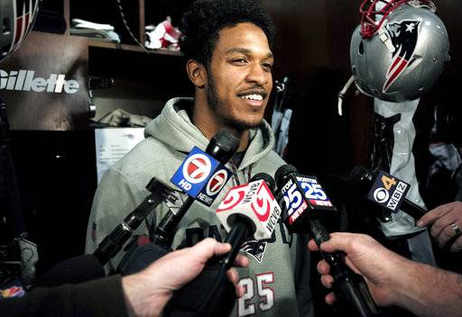 FILE - In this Wednesday, Jan. 24, 2018 file photo, New England Patriots cornerback Eric Rowe takes questions from reporters in the team's locker room in Foxborough, Mass. Eric Rowe was in a daze after being told he was being traded from Philadelphia to New England in September of 2016, wondering why the team that drafted in the second round a year earlier no longer wanted him.