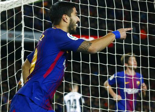 FC Barcelona's Luis Suarez celebrates after scoring during the Spanish Copa del Rey, semifinal, first leg, soccer match between FC Barcelona and Valencia at the Camp Nou stadium in Barcelona, Spain, Thursday, Feb. 1, 2018.