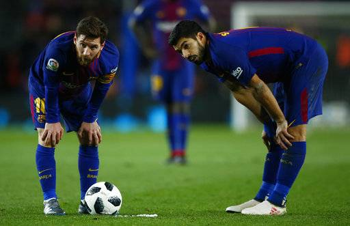 FC Barcelona's Lionel Messi, left, and Luis suarez during the Spanish Copa del Rey, semifinal, first leg, soccer match between FC Barcelona and Valencia at the Camp Nou stadium in Barcelona, Spain, Thursday, Feb. 1, 2018.
