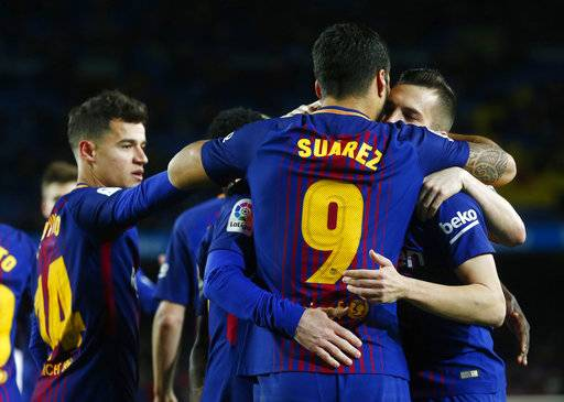 FC Barcelona's Luis Suarez, back, celebrates after scoring during the Spanish Copa del Rey, semifinal, first leg, soccer match between FC Barcelona and Valencia at the Camp Nou stadium in Barcelona, Spain, Thursday, Feb. 1, 2018.