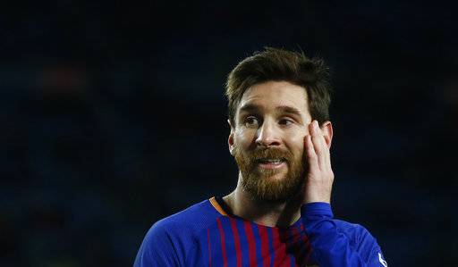 FC Barcelona's Lionel Messi gestures during the Spanish Copa del Rey, semifinal, first leg, soccer match between FC Barcelona and Valencia at the Camp Nou stadium in Barcelona, Spain, Thursday, Feb. 1, 2018.