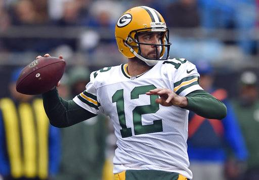 FILE - In this Dec. 17, 2017, file photo, Green Bay Packers' Aaron Rodgers looks to pass against the Carolina Panthers during the first half of an NFL football game in Charlotte, N.C. Rodgers wants to follow Tom Brady's path and still chuck it when he's in his 40s. He also accepts that in today's NFL he might again follow Brett Favre's footsteps and one day don something other than the green and gold.