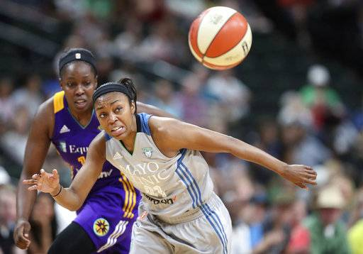 FILE- In this July 6, 2017, file photo, Minnesota Lynx guard Renee Montgomery, front, and Los Angeles Sparks guard Chelsea Gray watch the ball get away during the second quarter of a WNBA basketball game in St. Paul, Minn. Montgomery, who won two WNBA championships with the Minnesota Lynx, has signed a multi-year contract with the Atlanta Dream.  (Elizabeth Flores/Star Tribune via AP, File)