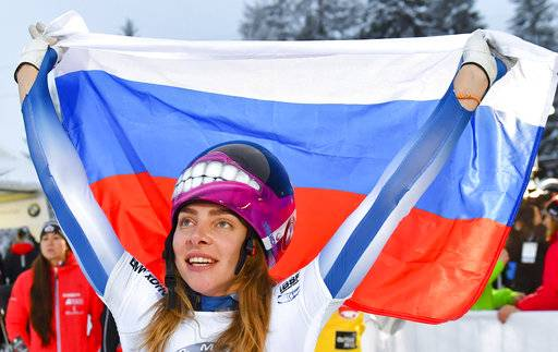 FILE - In this Friday, Dec. 15, 2017 file photo, Russia's winner Elena Nikitina celebrates after the women's Skeleton World Cup race in Innsbruck, Austria. Russian skeleton slider Elena Nikitina says she's aiming to compete at the Pyeongchang Olympics after the Court of Arbitration for Sport overturned her doping ban.