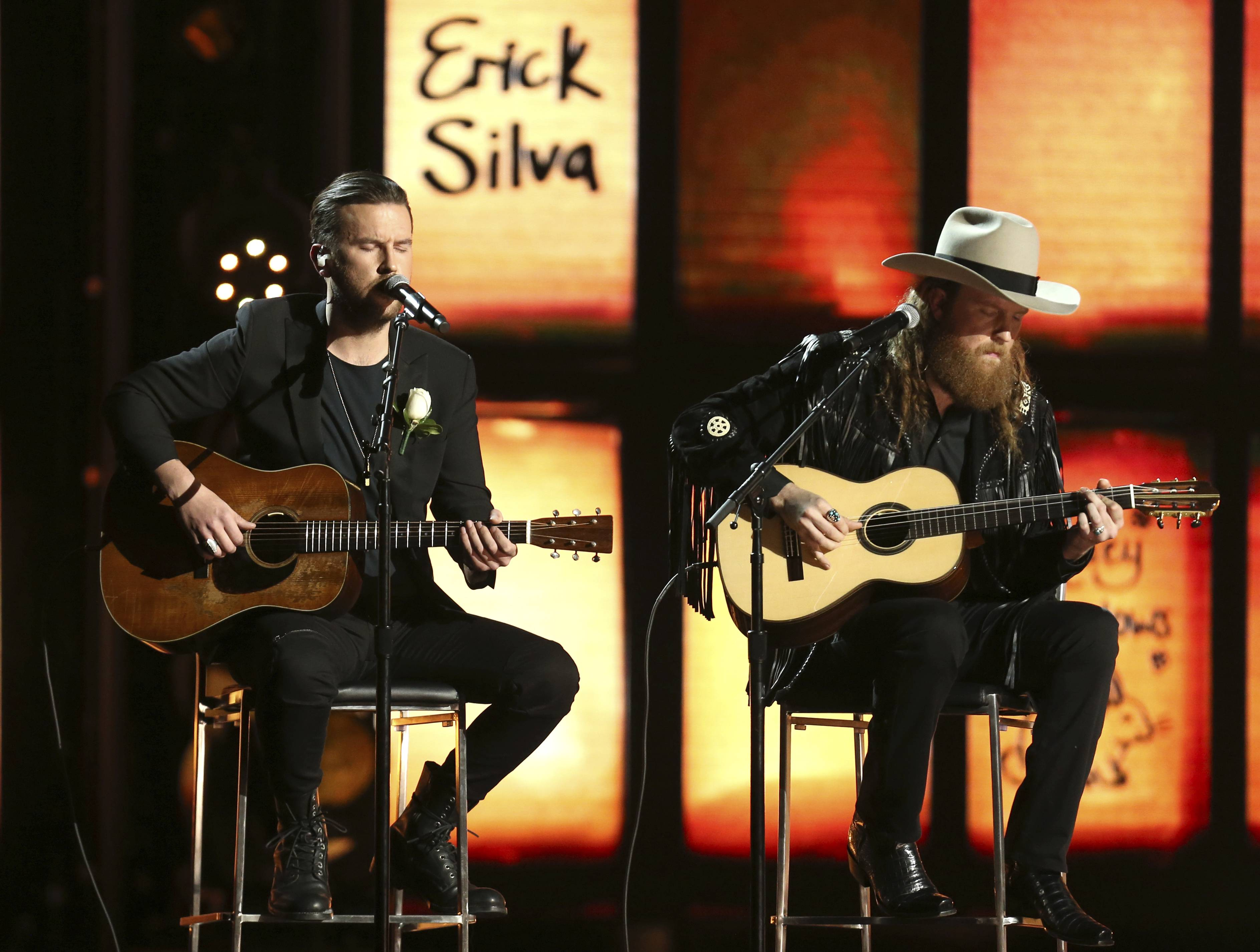 The Brothers Osborne performed as names of victims of tragedies appear on-screen at the 60th annual Grammy Awards at Madison Square Garden on Sunday.