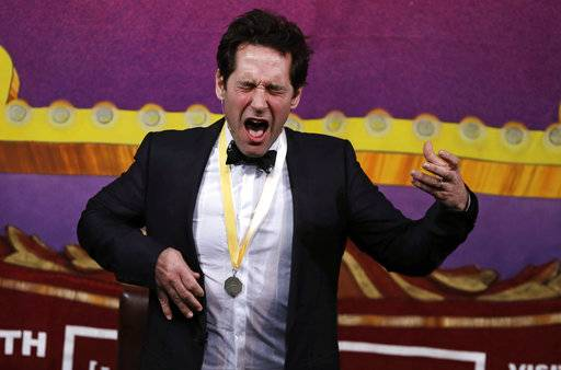 "Actor Paul Rudd plays air guitar during a roast at Harvard University in Cambridge, Mass., Friday, Feb. 2, 2018. Rudd was honored as ""Man of the Year"" by the Hasty Pudding Theatricals at Harvard."