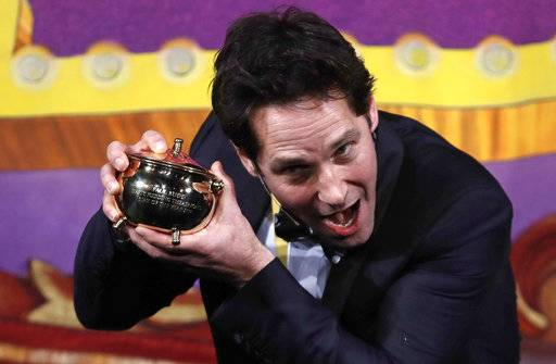 "Actor Paul Rudd holds his pudding pot trophy during a roast at Harvard University in Cambridge, Mass., Friday, Feb. 2, 2018. Rudd was honored as ""Man of the Year"" by the Hasty Pudding Theatricals at Harvard."