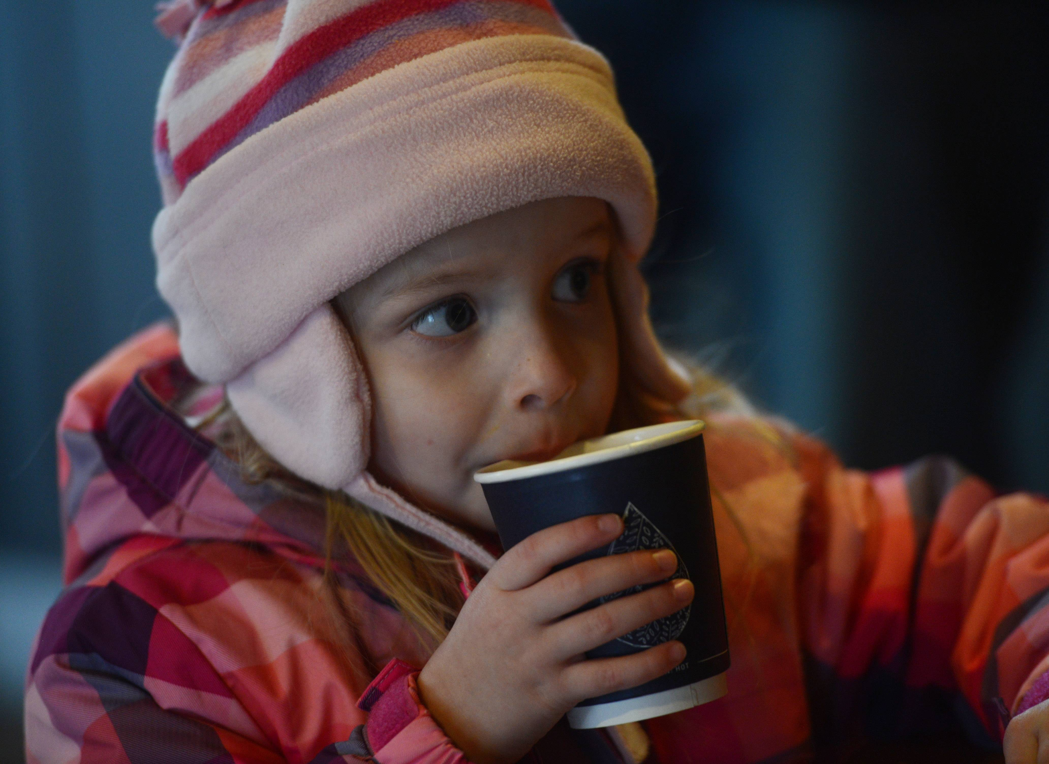 Tabitha Wagner, 4, of Elk Grove Village sips hot cocoa supreme at the Covered Bridge Creamery during the Long Grove Cocoa Crawl Saturday.