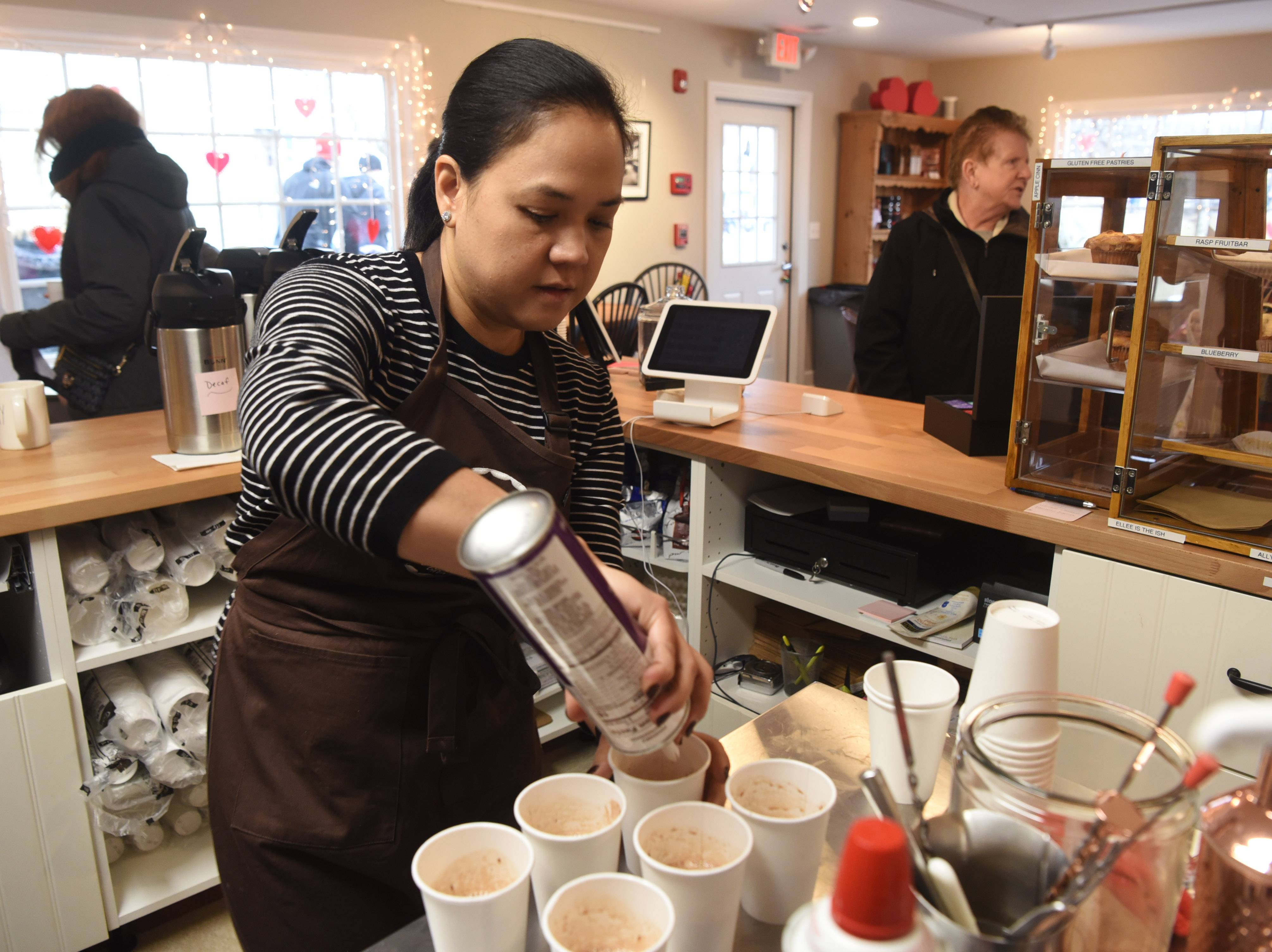 Ethel Berger prepares hot chocolate at the Long Grove Coffee Co. during the Long Grove Cocoa Crawl Saturday.