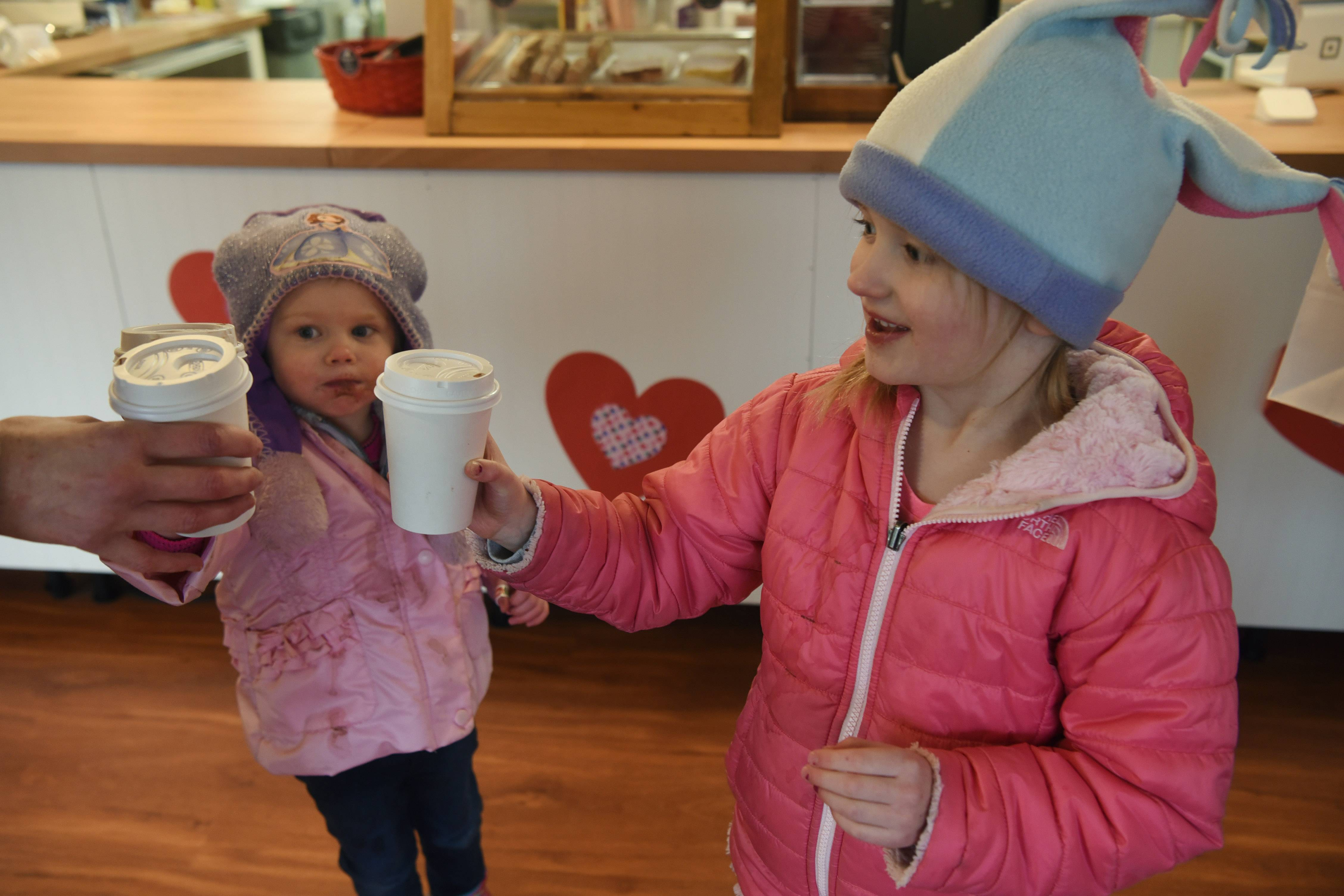 Emersyn Saari, 2½, of Lincolnshire, left, and her sister, Dylan, 4½, enjoy hot chocolate at the Long Grove Coffee Co. during the Long Grove Cocoa Crawl Saturday.