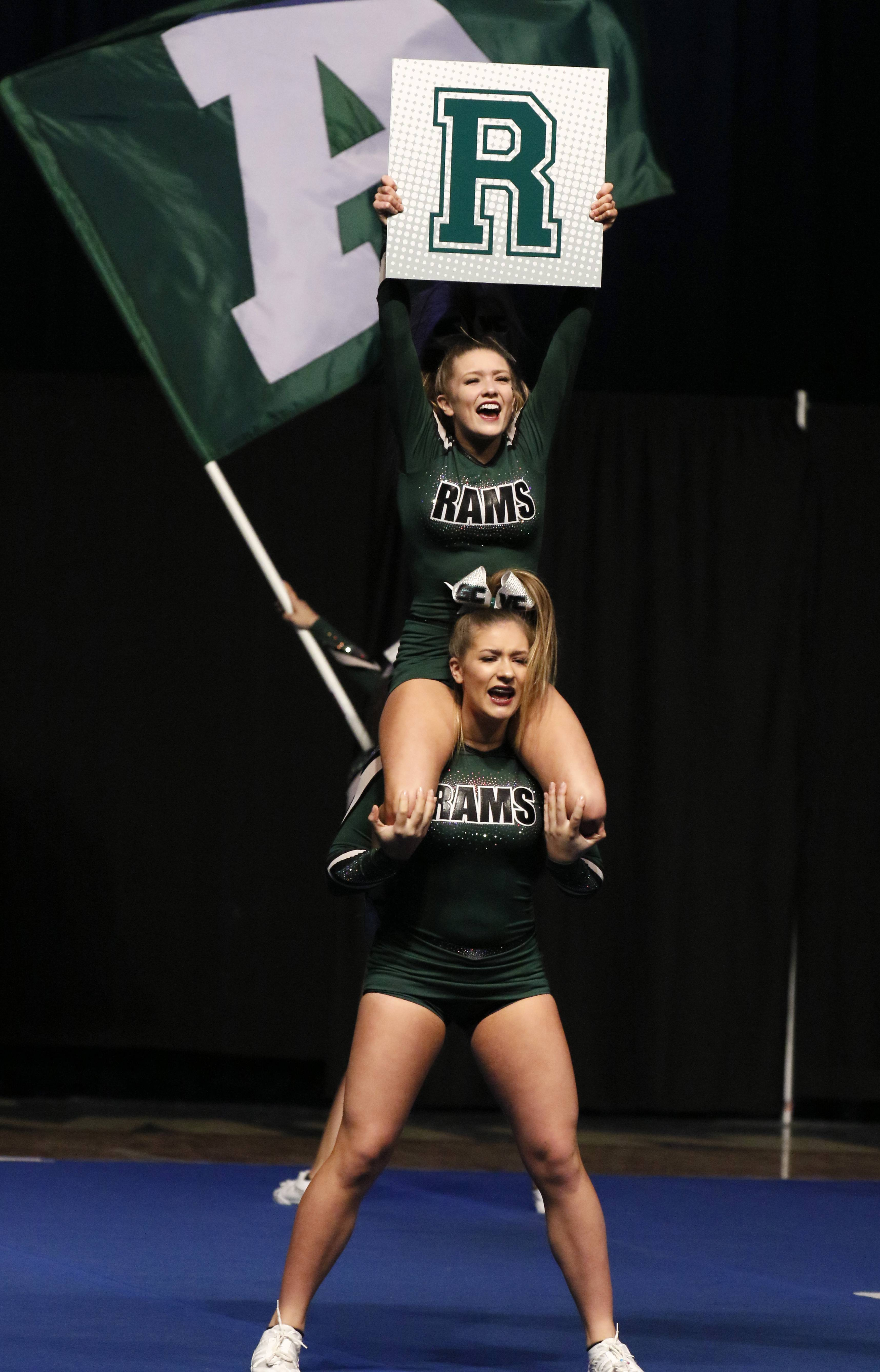 Grayslake Central High School competes Friday during the preliminary round of the IHSA state cheerleading competition at the Grossinger Motors Arena in Bloomington.