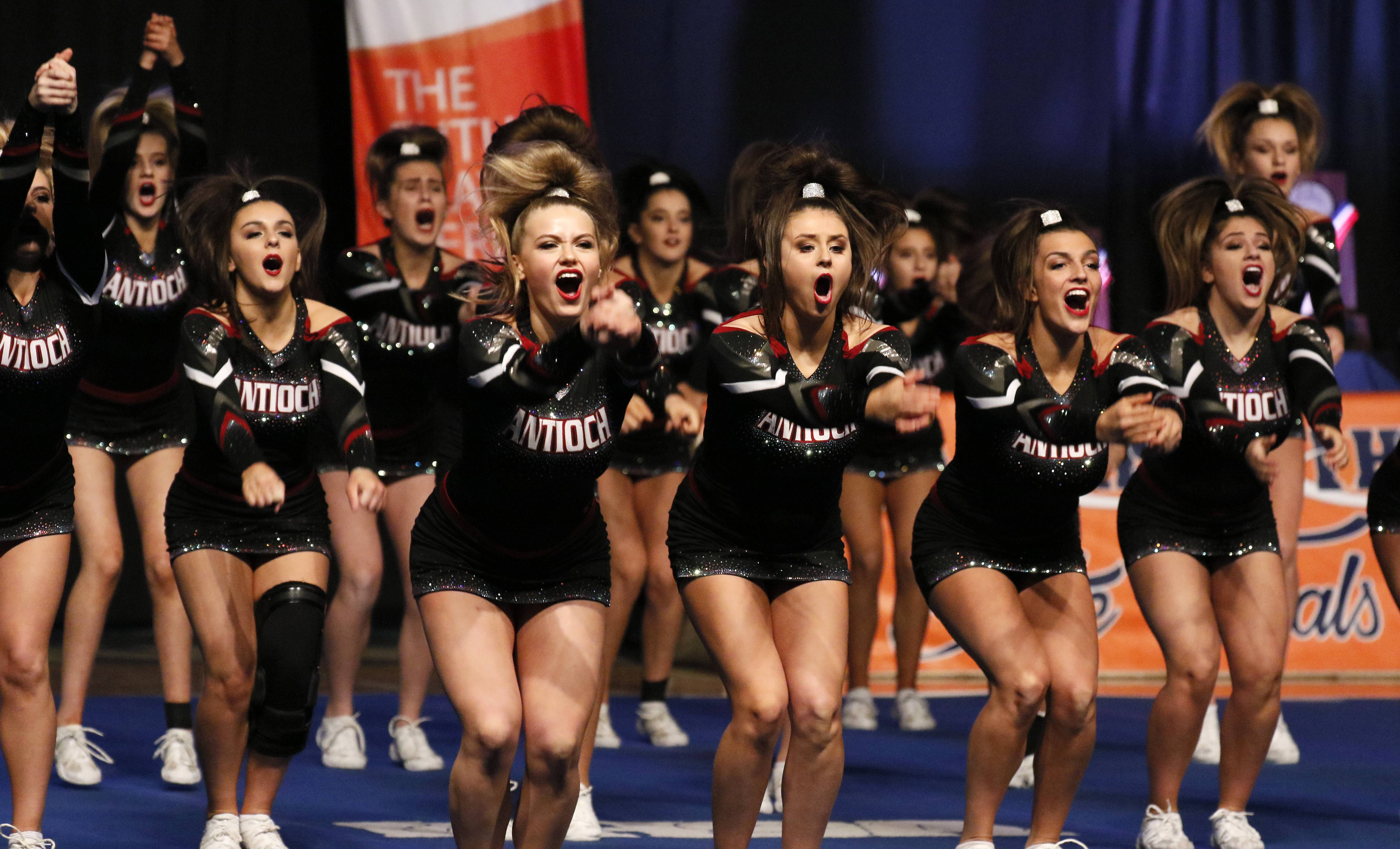 Antioch High School competes during the preliminary round of the IHSA state cheerleading competition at the Grossinger Motors Arena in Bloomington. Antioch advanced to Saturday's final round.