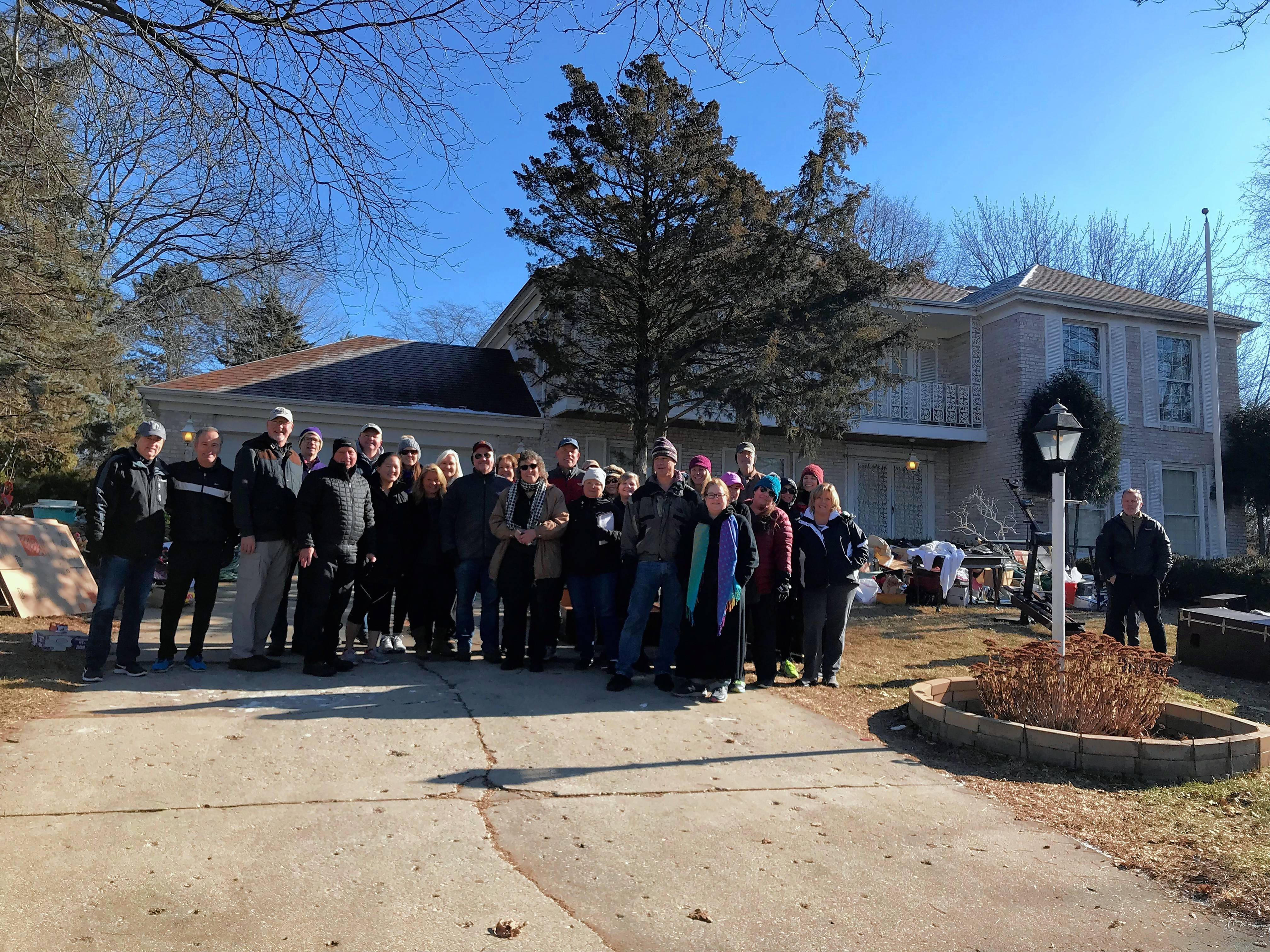 These are some of nearly 50 residents in the Fox Point subdivision in Barrington who helped an elderly couple and their daughter who were evicted from their house and had to beat a deadline Tuesday morning to have their furniture and other belongings off their Surrey Lane property.