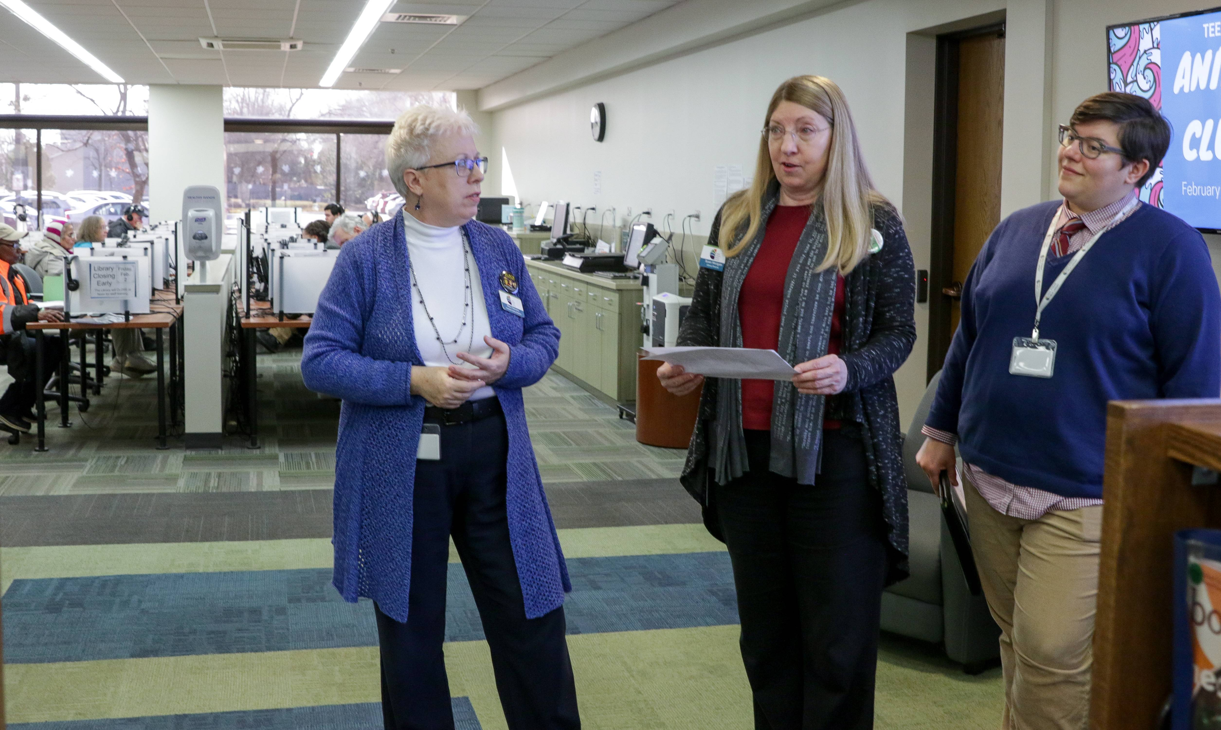 Carol Stream Public Library Assistant Director Mary Clemens, Director Susan Westgate, and Allison Porch, marketing coordinator, talk over plans for a $5.4 million renovation. The computer area behind them would become a new early literacy area.