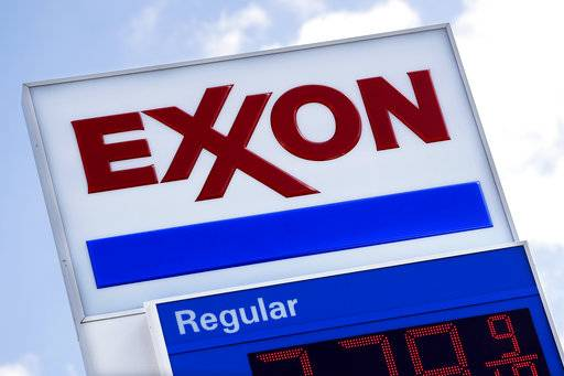 This April 25, 2017, photo, shows an Exxon service station sign in Nashville, Tenn. Exxon Mobil Corp. reports earnings Friday, Feb. 2, 2018.