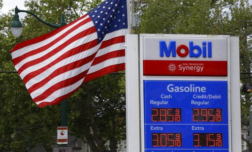 In this Tuesday, April 25, 2017, photo, gas prices are displayed at a Mobil station in Alameda, Calif. Exxon Mobil Corp. reports earnings Friday, Feb. 2, 2018.