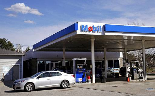 In this Monday, April 24, 2017, photo, a car drives away from a Mobil gasoline station in Londonderry, N.H. Exxon Mobil Corp. reports earnings Friday, Feb. 2, 2018.