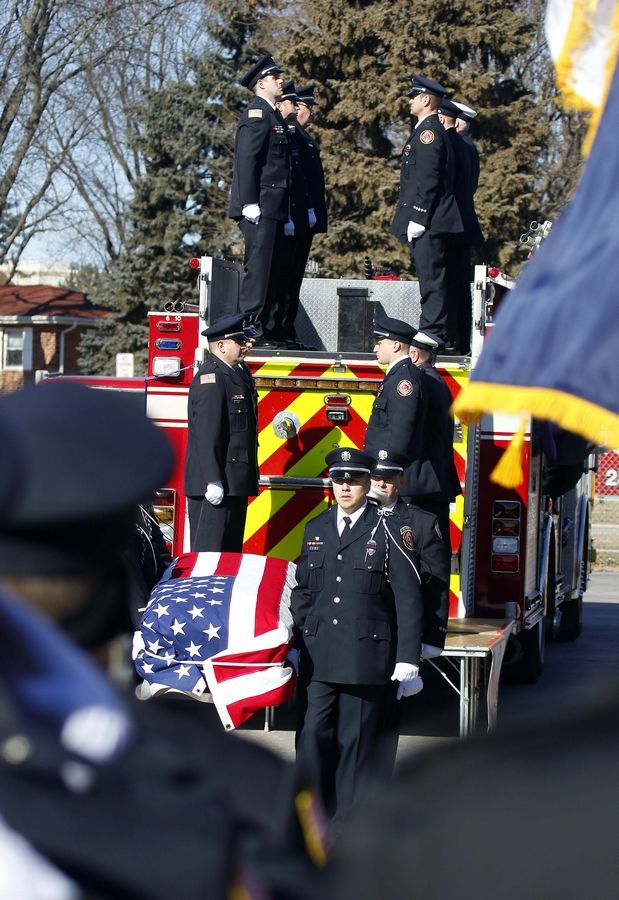 Buffalo Grove firefighter/paramedic Kevin Hauber, 51, is brought into St. Mary's Church in Buffalo Grove.