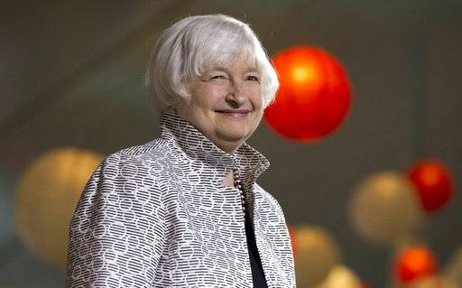 FILE - In this Friday, May 5, 2017, file photo, Federal Reserve Chair Janet Yellen smiles before giving a speech during a conference at Brown University in Providence, R.I. Yellen's last day at the Fed is Friday, Feb. 2, 2018. Then she will start a new job on Monday, Feb. 5 at the Brookings Institution.