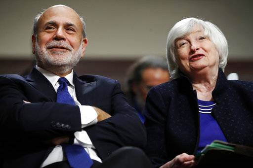 FILE - In this Tuesday, Nov. 7, 2017, file photo, former Federal Reserve Chair Ben Bernanke, left, and Federal Reserve Chair Janet Yellen attend a ceremony awarding them both with the Paul H. Douglas Award for Ethics in Government, on Capitol Hill in Washington. Yellen's last day at the Fed is Friday, Feb. 2, 2018. Then she will start a new job on Monday, Feb. 5 at the Brookings Institution, where one of her colleagues will be Bernanke.