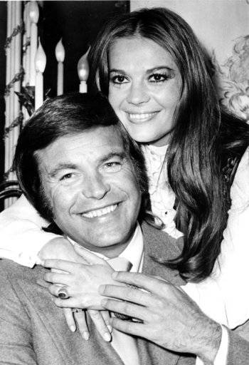 "FILE - In this April 23, 1972 file photo, actor Robert Wagner and his former wife, actress Natalie Wood, pose at the Dorchester Hotel in London, England. Investigators are now calling Wagner a ""person of interest"" in the 1981 death of his wife Natalie Wood. Mystery has swirled around Wood's death. It was declared an accident but police reopened the case in 2011 to see whether Wagner or anyone else played a role"