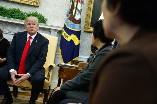 President Donald Trump meets with North Korean defectors in the Oval Office of the White House, Friday, Feb. 2, 2018, in Washington.