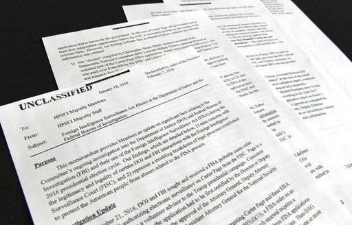 A intelligence memo is photographed in Washington, Friday, Feb. 2, 2018. After President Donald Trump declassified the memo, the Republican-led House Intelligence Committee released it based on classified information that alleges the FBI abused U.S. government surveillance powers in its investigation into Russian election interference.
