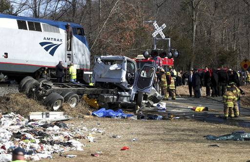 "FILE - In this Wednesday, Jan. 31, 2018 file photo, emergency personnel work at the scene of a collision between an Amtrak passenger train carrying dozens of GOP lawmakers and a garbage truck in Crozet, Va. On Friday, Feb. 2, 2018, The Associated Press has found that stories circulating on the internet claiming the accident was a ""deep state� assassination attempt are untrue. (Zack Wajsgrasu/The Daily Progress via AP)"