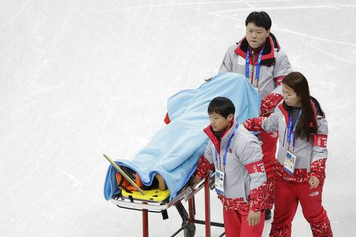 CORRECT TO NORTH KOREA, NOT SOUTH KOREA - North Korea's Choe Un Song, covered with a blanket, is carried on a stretcher after a crash during a Men's Short Track Speed Skating training session ahead of the 2018 Winter Olympics in Gangneung, South Korea, Friday, Feb. 2, 2018.